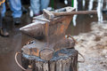 Old anvil with blacksmith tools on the outdoors Stock Photography