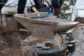 Old anvil with blacksmith tools on the outdoors Royalty Free Stock Photo