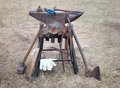Old anvil with many blacksmith tools Stock Photo