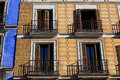 Old apartment building with balconies ornate facade in madrid spain Stock Image
