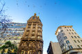 Old apartment building historic in san telmo neighborhood of buenos aires argentina with birds flying above Royalty Free Stock Photography