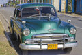 Old aqua green classic car carparked on a street in vinales cuba past international embargoes have meant cuba has maintained many Stock Images