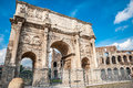 Old arch in rome ruins of an odl near the coliseum italy Royalty Free Stock Image