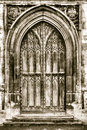 Old arched door in sepia tone hdr Stock Photography