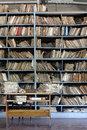 Old archive shelves full of files in a messy fashioned Stock Image