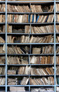 Old archive shelves full of files in a messy fashioned Stock Photo