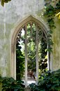 Arches of a ruined building now covered in vines. Royalty Free Stock Photo