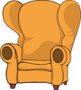 Old armchair big yellow with brown legs Royalty Free Stock Image