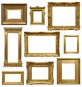 Old art gallery frames different period stlyles of antique gold picture isolated on white background Royalty Free Stock Photos