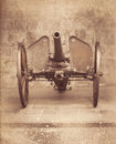 Old artillery iron cannon over wheel. Royalty Free Stock Photo
