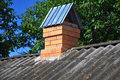 Old asbestos roof with new brick chimney. Royalty Free Stock Photo