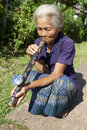 Old Asian woman with opium pipe Royalty Free Stock Image