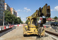 Old auto crane on a streetcar construction site an resting in bucharest working in progress for the rehabilitation of railway the Royalty Free Stock Photo