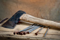 Old ax with nails still life hatchet and Royalty Free Stock Photography