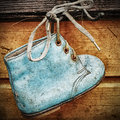 Old baby shoes as wall decoration Stock Images