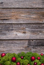 Old background of wood with red xmas balls and moss. Royalty Free Stock Photo