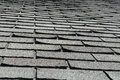 Old bad and curling roof shingles on a house or home here comes another expensive improvement project the contractor is going Royalty Free Stock Photo