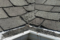 Old Bad and Curling Roof Shingles on a House or Home Royalty Free Stock Photo