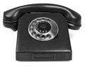Old bakelite telephone with spining dial on white background Stock Photography