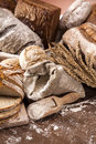 Old bakery traditional set of bread loaves and other ingredients Stock Images