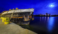 Old barge at night moored in the marina in szczecin poland Royalty Free Stock Image