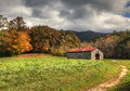 Old barn with beautiful fall colors and cloudy skies Stock Photo