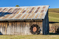 Old Barn with blue sky and wagon wheels Royalty Free Stock Images