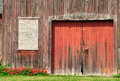 Old barn door red in need of repainting Royalty Free Stock Photography