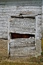 Old Barn Door is Rickety,Sagging, and Broken Royalty Free Stock Photo