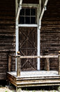 Old barn door with stoop and railing a wooden at the top of a on weathered building Stock Photography