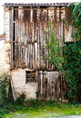 Old barn enclosed by old wooden boards. Royalty Free Stock Photo