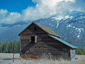 Old Barn, hand water pump and mountains Stock Image