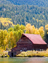 Old barn by the lake in autumn near lake city colorado Stock Images
