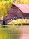 Old barn by the lake in autumn near lake city colorado Stock Photos