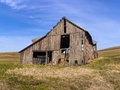 Old barn on the palouse an run down in a field near potlach idaho Royalty Free Stock Photo