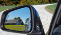 Old barn in rearview mirror Royalty Free Stock Photo