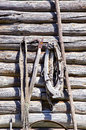 Old barn wall with vintage agriculture tools Stock Photography