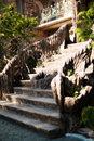 Old baroque stairs, outdoors. Stairs made of stone, small fountain with running water in the middle