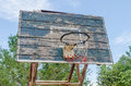 Old basketball hoop on a blue sky and forest Stock Photo