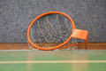 Old basketball hoop with net the floor of a school gym Royalty Free Stock Image