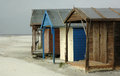 Old beach huts uk in a small sand storm west sussex coastal town Royalty Free Stock Image