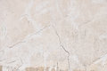 Old beige pink painted plaster wall with cracks Royalty Free Stock Photo