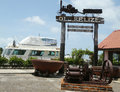 Old belize museum and cucumber beach sign in belize city june on june is a Royalty Free Stock Image