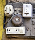 Old bell buttons rundown at a wall Royalty Free Stock Photo
