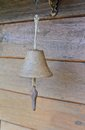 Old bell wooden wall Stock Photography