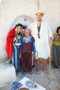 Old berber woman matmata tunisia september couple dressed in a s clothing with a in front of a troglodyte home tasting local Stock Photos