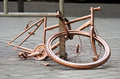 Old bicycle abandoned gold on street Royalty Free Stock Photo