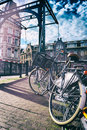 Old bicycle on bridge amsterdam cityscape at spring time Stock Photo