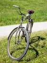 Old bicycle at a meadow Stock Photos