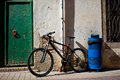 Old bicycle near the ancient walls and doors Royalty Free Stock Photos